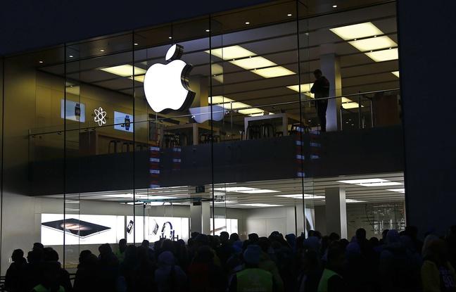 648x415_clients-attendent-devant-apple-store-munich-lancement-iphone-6s-25-septembre-2015